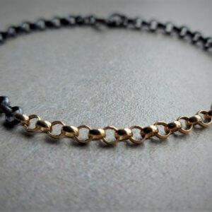 geoxideerd zilveren jasseron armband met gouden tussenstuk