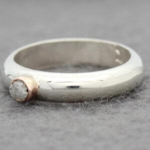 zilveren ring met ruwe diamant in rood goud gevat