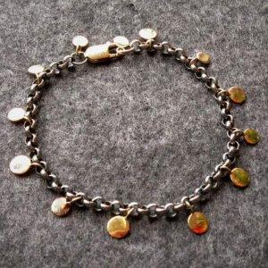 geoxideerde zilveren armband met gouden plaatjes